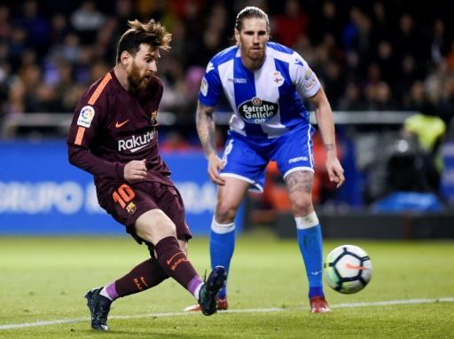 Lionel Messi scored two late goals to end Deportivo's resistance and wrap up the La Liga title