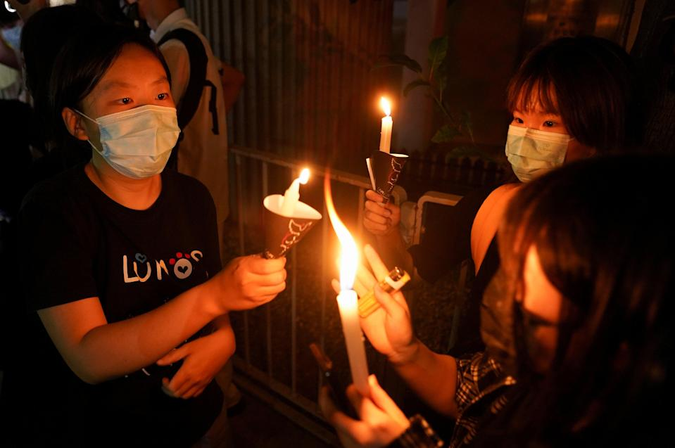 People light candles at Victoria Park on the 32nd anniversary of the crackdown on pro-democracy demonstrators at Beijing's Tiananmen Square in 1989, in Hong Kong, China 4 June 2021 (REUTERS)