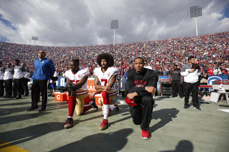 Eli Harold #58, Colin Kaepernick #7 and Eric Reid #35 of the San Francisco 49ers kneel on the sideline, during the anthem, prior to the game against the Los Angeles Rams at the Los Angeles Coliseum on December 24, 2016 in Los Angeles, California.  (Michael Zagaris via Getty Images)