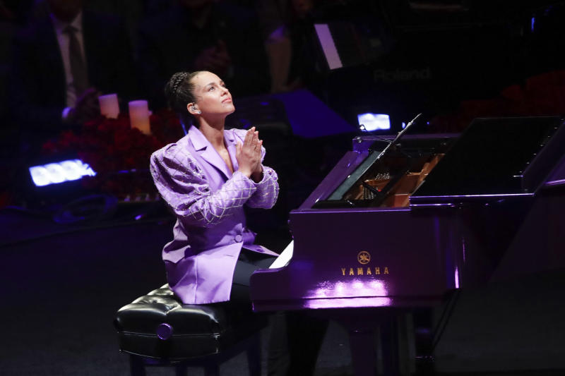 Alicia Keys reacts after performing during a celebration of life for Kobe Bryant and his daughter Gianna Monday, Feb. 24, 2020, in Los Angeles. (AP Photo/Marcio Jose Sanchez)