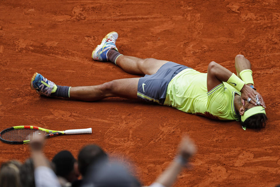 FILE - In this June 9, 2019, file photo, Spain's Rafael Nadal celebrates his record 12th French Open tennis tournament title, after winning the men's final against Austria's Dominic Thiem in four sets, 6-3, 5-7, 6-1, 6-1, at Roland Garros stadium in Paris. Nadal will be competing in the 2019 Wimbledon tournament.(AP Photo/Jean-Francois Badias, File)