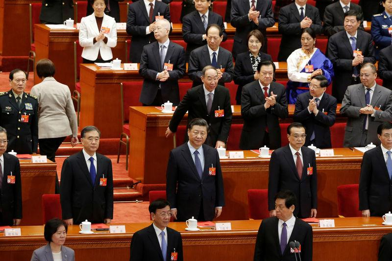 Chinese President Xi Jinping and Chinese Premier Li Keqiang attend the closing session of the National People's Congress (NPC) at the Great Hall of the People in Beijing