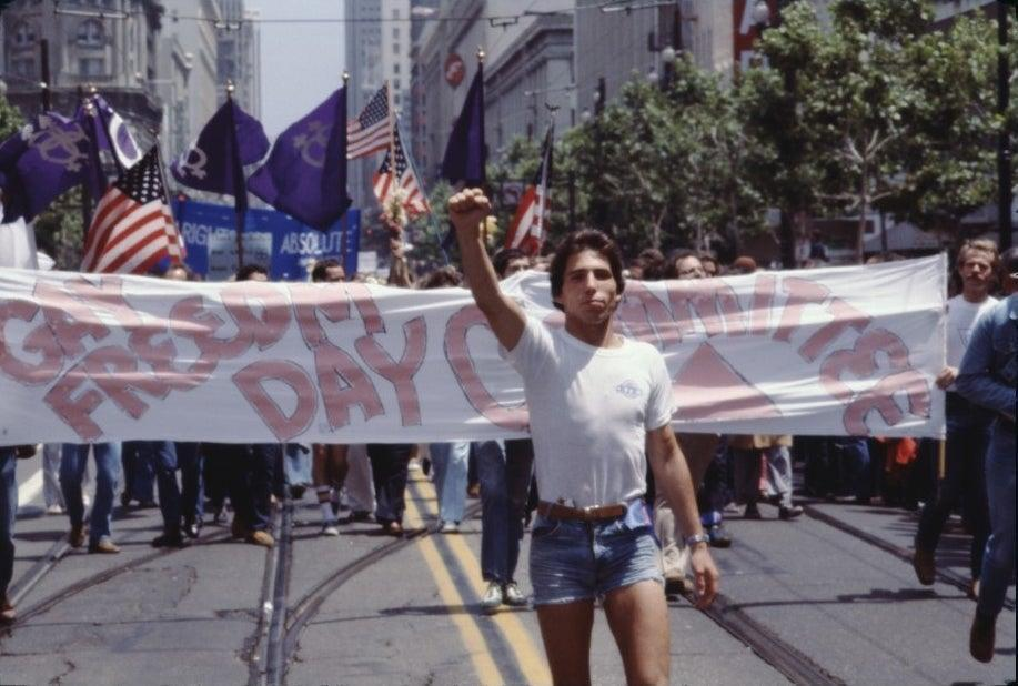 A marcher in jorts at a 1977 Gay Pride March