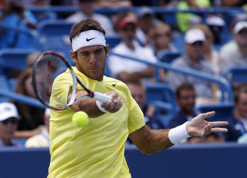 Juan Martin Del Potro, from Argentina, hits against John Isner, from the United States, during a semi-final match at the Western & Southern Open tennis tournament, Saturday, Aug. 17, 2013, in Mason, Ohio. (AP Photo/David Kohl)