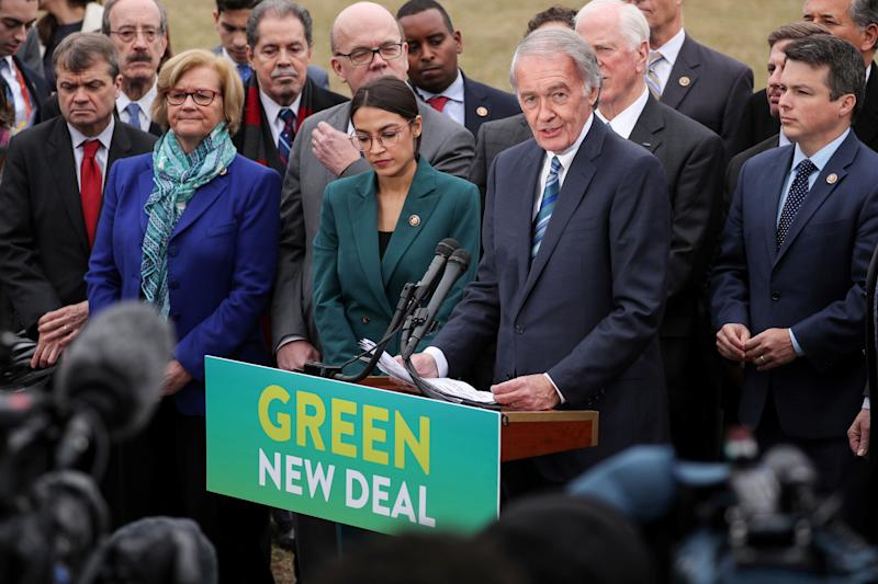 "FILE PHOTO: U.S. Representative Alexandria Ocasio-Cortez (D-NY) and Senator Ed Markey (D-MA) hold a news conference for their proposed ""Green New Deal"" to achieve net-zero greenhouse gas emissions in 10 years, at the U.S. Capitol in Washington, U.S. February 7, 2019. REUTERS/Jonathan Ernst/File Photo"