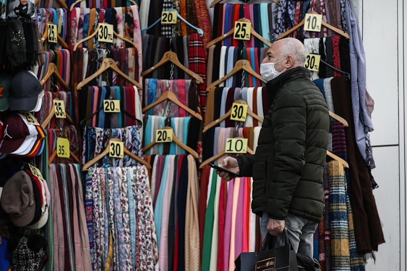 ISTANBUL, TURKEY - MAY 7: A man shops at nearly empty Istiklal Street as people stay at home within coronavirus (Covid-19) precautions in Istanbul, Turkey on May 7, 2020. (Photo by Onur Coban/Anadolu Agency via Getty Images)