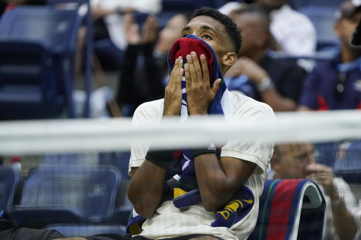 Felix Auger-Aliassime, of Canada, reacts after losing to Daniil Medvedev, of Russia, during the semifinals of the US Open tennis championships, Friday, Sept. 10, 2021, in New York. (AP Photo/Seth Wenig)