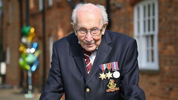 PHOTO: British World War II veteran Captain Tom Moore poses doing a lap of his garden in the village of Marston Moretaine, 50 miles north of London, April 16, 2020. (Justin Tallis/AFP via Getty Images, FILE)