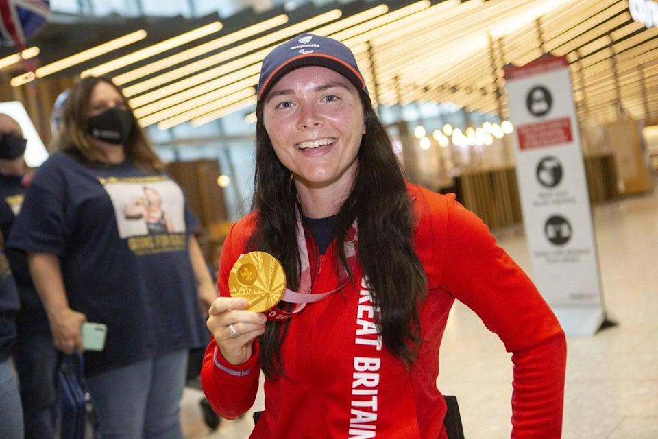 Gold medalist Lauren Rowles arrives back at London Heathrow (Rick Findler/PA) (PA Wire)