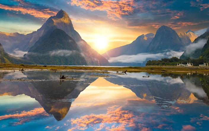 Mitre Peak rises from Milford Sound fiord in New Zealand - . Contributor
