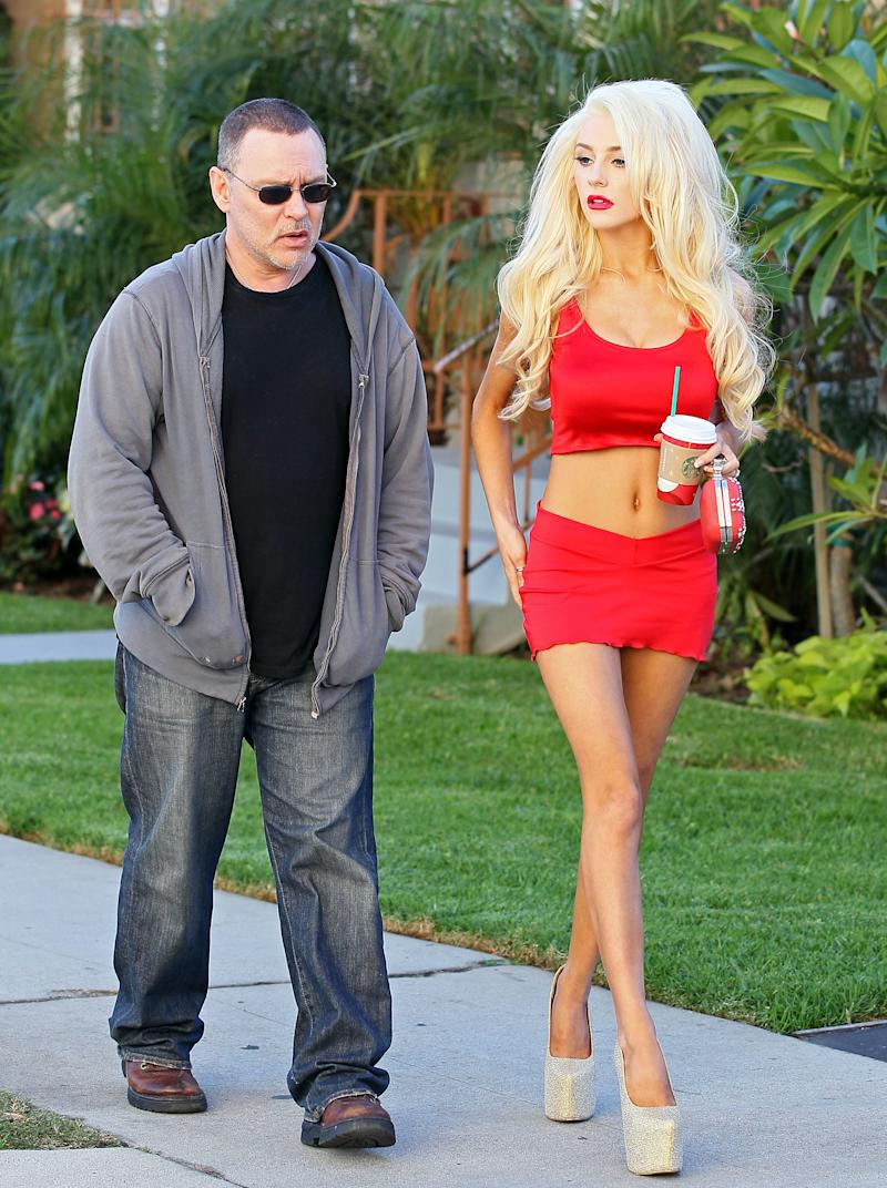 Courtney wears red crop top and mini skirt with husband Doug Hutchinson in 2013