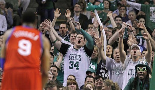 Boston Celtics fans try to distract Philadelphia 76ers' Andre Iguodala (9) on a foul shot during the second quarter of Game 5 in their NBA basketball Eastern Conference semifinal playoff series in Boston, Monday, May 21, 2012. (AP Photo/Charles Krupa)