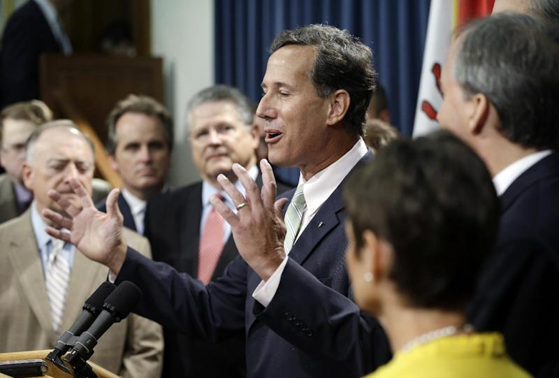 FILE - In this July 11, 2013, file photo, former Pennsylvania Sen. Rick Santorum, center, speaks during a news conference outside the Senate Chambers in Austin, Texas. A Senate committee on Thursday pushed through new abortion restrictions, setting up a Senate vote before the weekend to send it to Gov. Rick Perry. The bill would require doctors to have admitting privileges at nearby hospitals, only allow abortions in surgical centers, dictate when abortion pills are taken and ban abortions after 20 weeks. Having no immediate hope to overturn the U.S. Supreme Court's Roe v. Wade decision that legalized abortion nationwide, Republicans in capitols around the country have accelerated their push for legislative restrictions on the procedure, and Democrats say they'll make the GOP pay in coming elections. (AP Photo/Eric Gay)