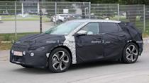 """<p>This heavily camouflaged development vehicle appears to share some design DNA with the <a href=""""https://www.motor1.com/news/380363/kia-futuron-concept-revealed/"""" rel=""""nofollow noopener"""" target=""""_blank"""" data-ylk=""""slk:Kia Futuron concept from 2019"""" class=""""link rapid-noclick-resp"""">Kia Futuron concept from 2019</a>.</p> <h3><a href=""""https://www.motor1.com/news/434465/kia-electric-suv-spy-photos/"""" rel=""""nofollow noopener"""" target=""""_blank"""" data-ylk=""""slk:Swoopy Kia Electric SUV Spied With Heavy Camouflage"""" class=""""link rapid-noclick-resp"""">Swoopy Kia Electric SUV Spied With Heavy Camouflage</a></h3> <br><a href=""""https://www.motor1.com/news/380363/kia-futuron-concept-revealed/"""" rel=""""nofollow noopener"""" target=""""_blank"""" data-ylk=""""slk:Kia Futuron Concept Takes Design Cues From UFOs And Flying Saucers"""" class=""""link rapid-noclick-resp"""">Kia Futuron Concept Takes Design Cues From UFOs And Flying Saucers</a><br>"""
