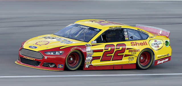 Joey Logano drives during qualifying for a NASCAR Sprint Cup Series auto race on Friday, March 7, 2014, in Las Vegas. Logano won the pole. (AP Photo/Isaac Brekken)