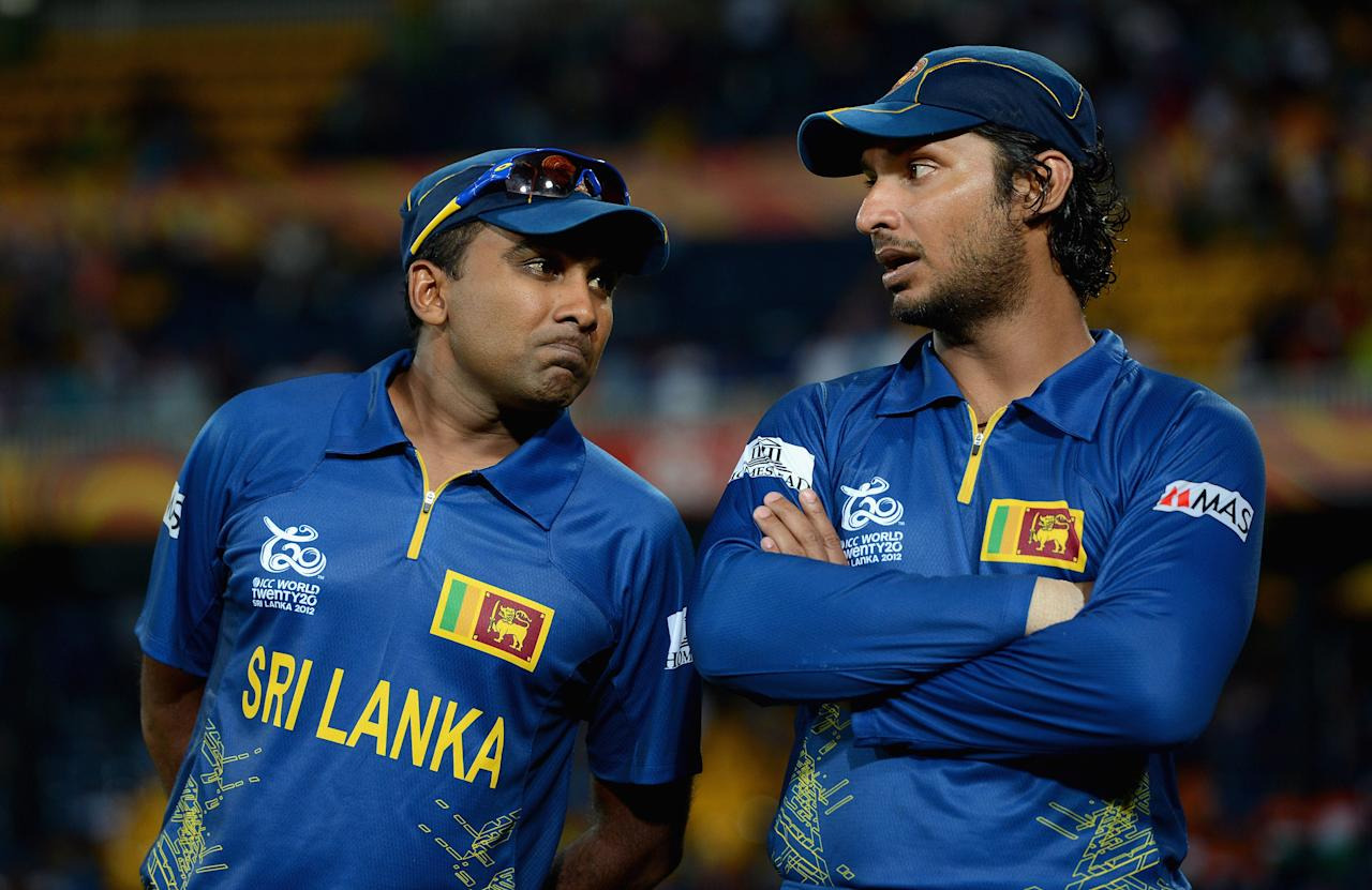 COLOMBO, SRI LANKA - OCTOBER 07:  Sri Lanka captain Mahela Jayawardene speaks to teammate 	 Kumar Sangakkara after losing the ICC World Twenty20 2012 Final between Sri Lanka and the West Indies at R. Premadasa Stadium on October 7, 2012 in Colombo, Sri Lanka.  (Photo by Gareth Copley/Getty Images)