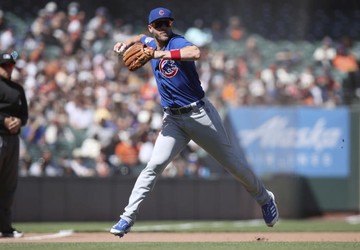 Chicago Cubs' Patrick Wisdom fields a ground ball and throws out San Francisco Giants' Mike Tauchman to end the eighth inning of a baseball game Sunday, June 6, 2021, in San Francisco. (AP Photo/Scot Tucker)