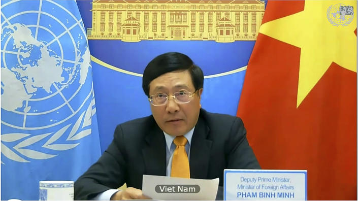In this image made from UNTV video, Vietnam's Foreign Minister Pham Bình Minh, speaks during a U.N. Security Council high-level meeting on COVID-19 recovery focusing on vaccinations, chaired by British Foreign Secretary Dominc Raab, Wednesday, Feb. 17, 2021, at UN headquarters, in New York. (UNTV via AP)