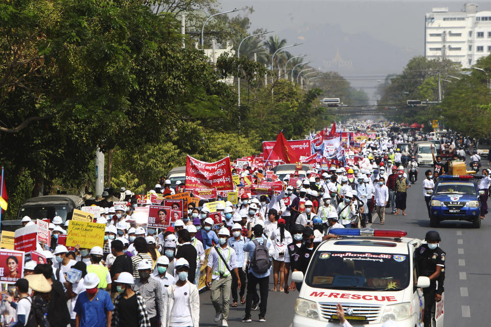 Thousands of students march along main road during an anti-coup street march in Mandalay, Myanmar, Friday, Feb. 26, 2021. Tensions escalated Thursday on the streets of Yangon, Myanmar's biggest city, as supporters of Myanmar's junta attacked people protesting the military government that took power in a coup, using slingshots, iron rods and knives to injure several of the demonstrators. (AP Photo)