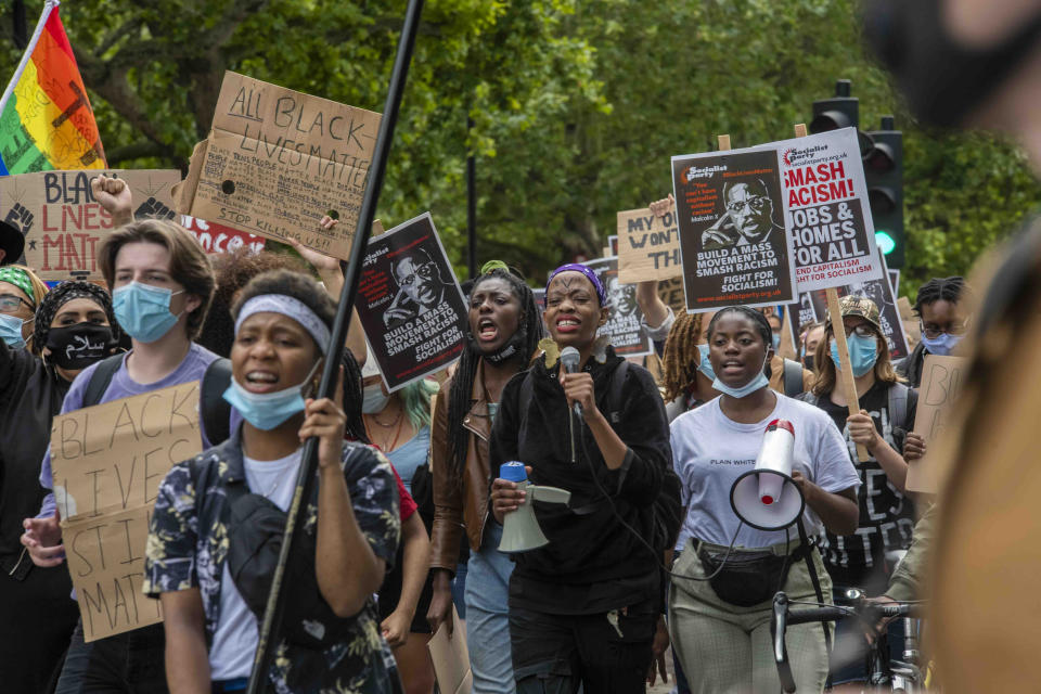 People during a protest march organised by Black Lives Matter from the US Embassy towards Parliament square, London on Saturday July 11, 2020