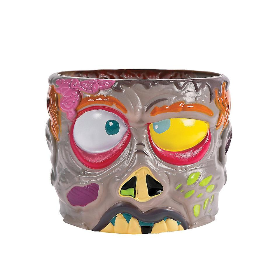 "<p>This <a href=""https://www.popsugar.com/buy/Zombie-Punch-Bowl-479912?p_name=Zombie%20Punch%20Bowl&retailer=amazon.com&pid=479912&price=18&evar1=yum%3Auk&evar9=46498977&evar98=https%3A%2F%2Fwww.popsugar.com%2Ffood%2Fphoto-gallery%2F46498977%2Fimage%2F46498985%2FZombie-Punch-Bowl&list1=halloween%2Calcohol&prop13=api&pdata=1"" rel=""nofollow"" data-shoppable-link=""1"" target=""_blank"" class=""ga-track"" data-ga-category=""Related"" data-ga-label=""https://www.amazon.com/LARGE-ZOMBIE-PLASTIC-PUNCH-Lightweight/dp/B00YFPW79S/ref=sr_1_3?keywords=halloween+punch+bowls&amp;qid=1565794407&amp;s=gateway&amp;sr=8-3"" data-ga-action=""In-Line Links"">Zombie Punch Bowl</a> ($18) is colorful and fun while still being perfectly creepy for your party.</p>"
