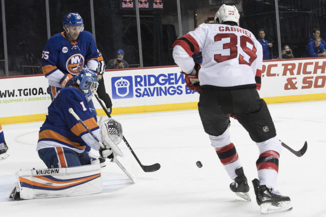 New York Islanders goaltender Thomas Greiss (1) makes the save against New Jersey Devils right wing Kurtis Gabriel (39) during the first period of an NHL hockey game, Saturday, Nov. 3, 2018, in New York. (AP Photo/Mary Altaffer)