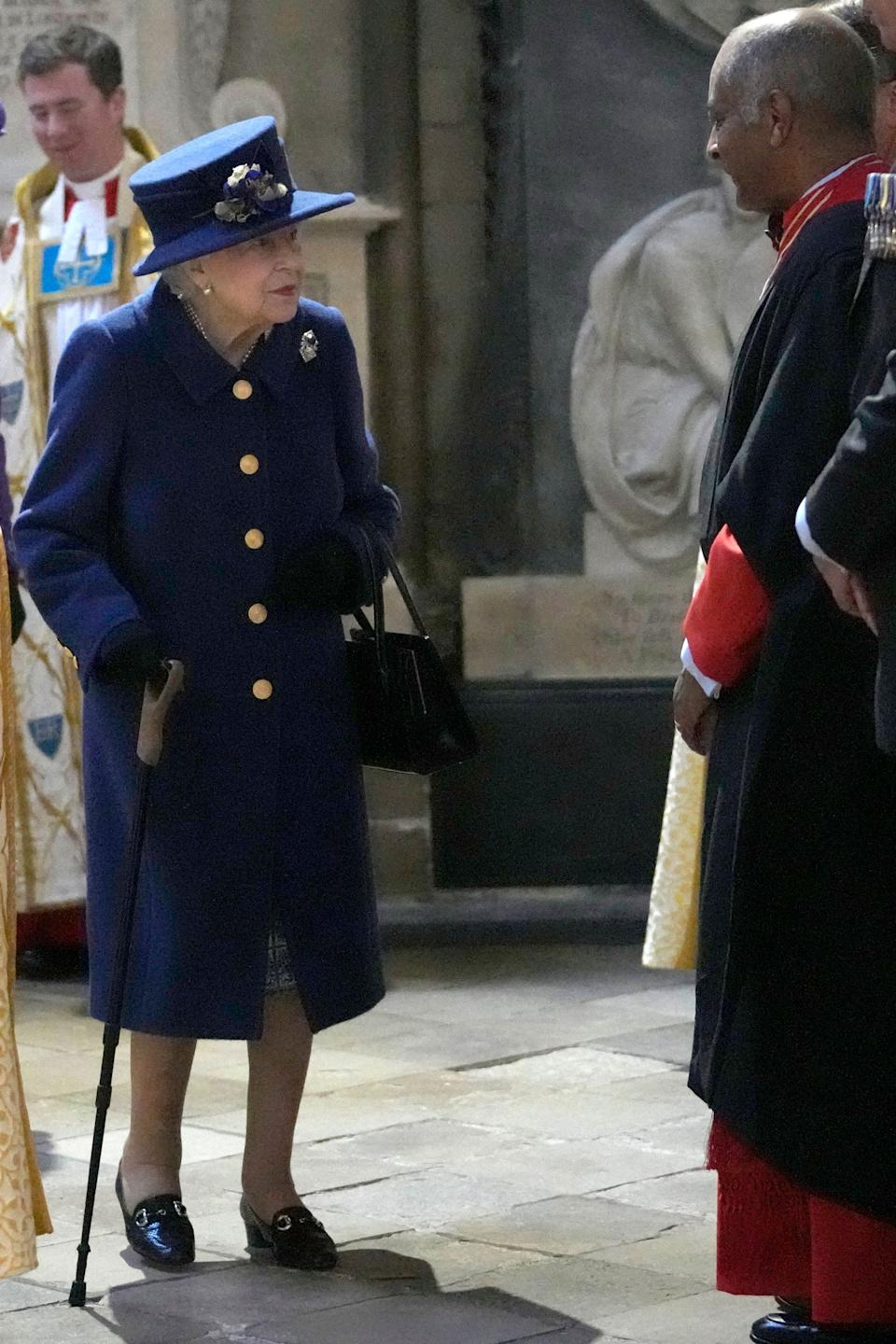 Britain's Queen Elizabeth II arrives to attend a Service of Thanksgiving to mark the Centenary of the Royal British Legion at Westminster Abbey in London on October 12, 2021. - The Royal British Legion has been celebrating its 100th Anniversary throughout 2021 with a special programme of activity, paying tribute to those who have contributed to its proud history and celebrating with the communities across the UK and around the world who are at its heart. (Photo by Frank Augstein / POOL / AFP) (Photo by FRANK AUGSTEIN/POOL/AFP via Getty Images)