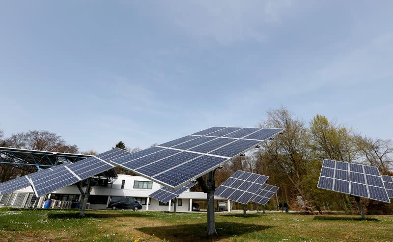 FILE PHOTO: Solar panels surround the entrance to the Wacker Chemie AG facility in the south-east Bavarian town of Burghausen