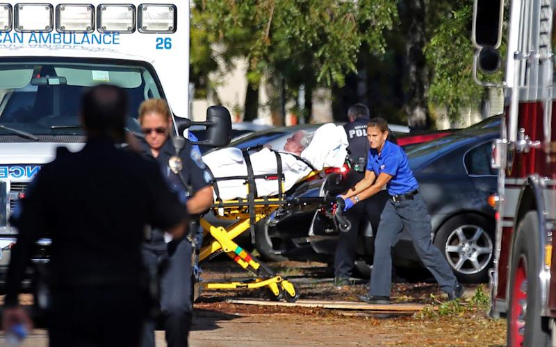 A woman is transported from The Rehabilitation Center at Hollywood Hills as patients are evacuated after a loss of air conditioning - South Florida Sun-Sentinel