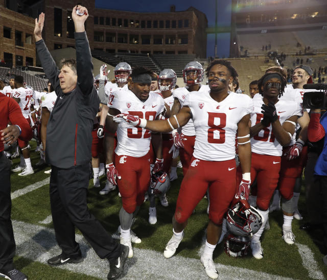 Washington State head coach Mike Leach's tenure at Texas Tech helped popularize the idea that throwing the ball can be more efficient than running it. (AP Photo/David Zalubowski)