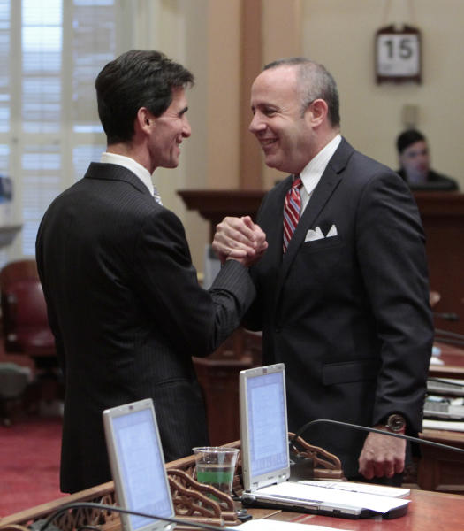 CORRECTS DATE TO FRIDAY, JUNE 15, 2012- State Senate President Pro Tem Darrell Steinberg, D-Sacramento, right, shakes hands with Senate Budge Committee Chairman Mark Leno, D-San Francisco, before the Senate took up the state budget at the Capitol in Sacramento, Calif., Friday, June, 15, 2012. The Senate approved the budget plan by a 23-16 vote and sent it to the Assembly.(AP Photo/Rich Pedroncelli)