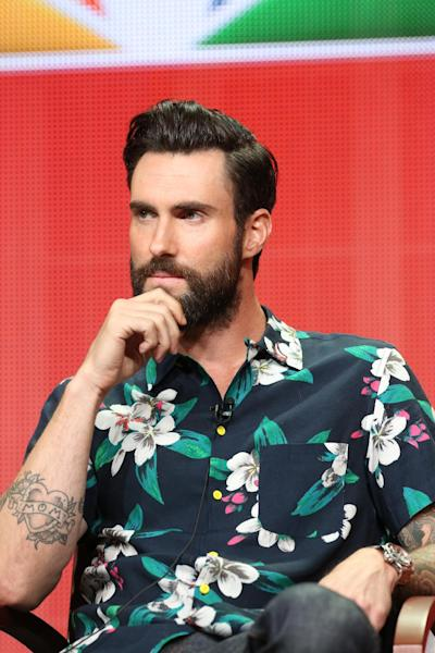 "This image released by NBC shows Adam Levine at ""The Voice"" session during the NBCUniversal Press Tour in Beverly Hills, Calif., on Saturday, July 27, 2013. (AP Photo/NBC, Chris Haston)"