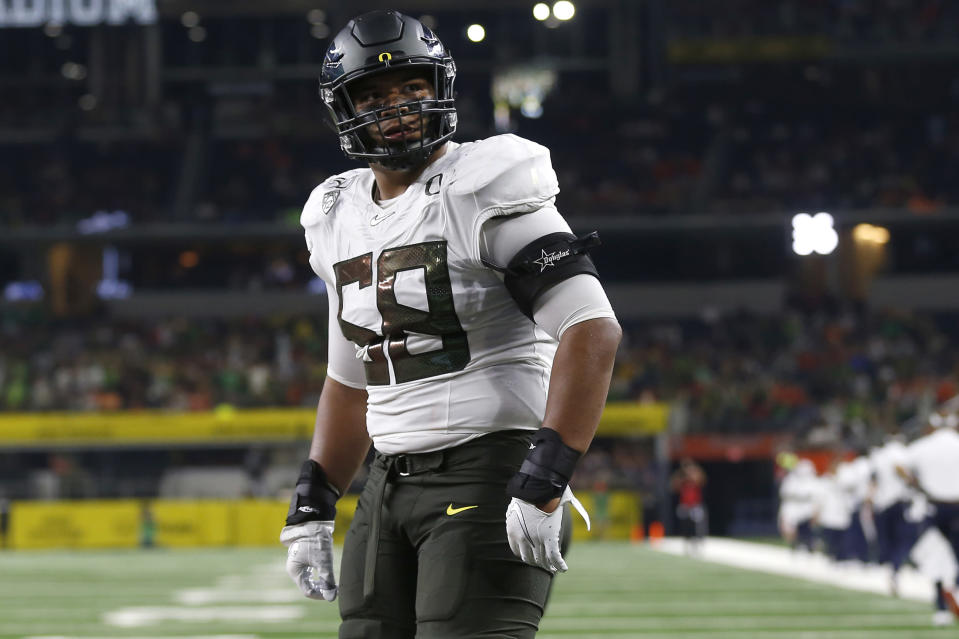 FILE - In this Aug. 31, 2019, file photo, Oregon offensive lineman Penei Sewell (58) looks on as Oregon plays Auburn in an NCAA college football game in Arlington, Texas. The last NFL event not impacted by the COVID-19 pandemic was the 2020 combine in Indianapolis. A year later, with the 2021 combine canceled, the league has released a list of players who would have merited invitations. From such high-profile quarterbacks as Clemson's Trevor Lawrence and Ohio State's Justin Fields to guys who sat out last season such as Oregon tackle Penei Sewell, there are 323 players from 100 schools. (AP Photo/Ron Jenkins, File)