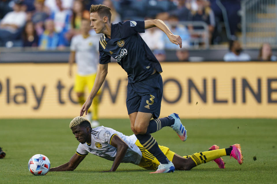 Philadelphia Union's Jack Elliott. right gets the ball past Columbus Crew's Gyasi Zerdes, left during the first half of an MLS soccer match, Wednesday, June 23, 2021, in Chester, Pa. (AP Photo/Chris Szagola)
