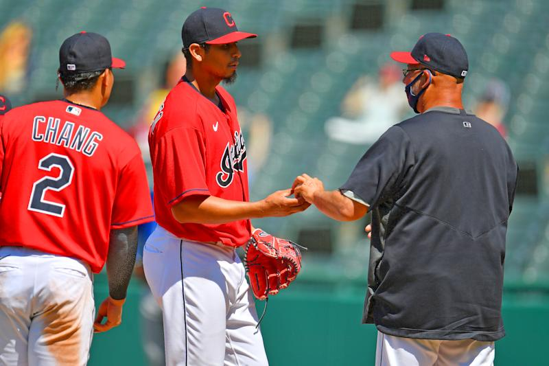 Cleveland pitcher Carlos Carrasco is removed from the game by manager Terry Francona, a common sight as starting pitchers are pulled early this season. (Photo by Jason Miller/Getty Images)