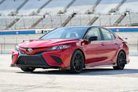 """<p>For 2020 a <a href=""""https://www.caranddriver.com/news/a28788191/2020-toyota-camry-trd-pricing/"""" rel=""""nofollow noopener"""" target=""""_blank"""" data-ylk=""""slk:Camry TRD sporty model"""" class=""""link rapid-noclick-resp"""">Camry TRD sporty model</a> was added with firmer suspension, racer-boy looks, but no power improvements from the 301-hp 3.5-liter V-6 already available in XSE and XLE trims. The spoilers and added aero aren't just there for looks, as the EPA-estimated combined mileage is down 1 mpg from other V-6 Camrys. Camry TRD pricing starts at $31,995, making it the cheapest way to get the Camry with a V-6 by $3960. </p>"""