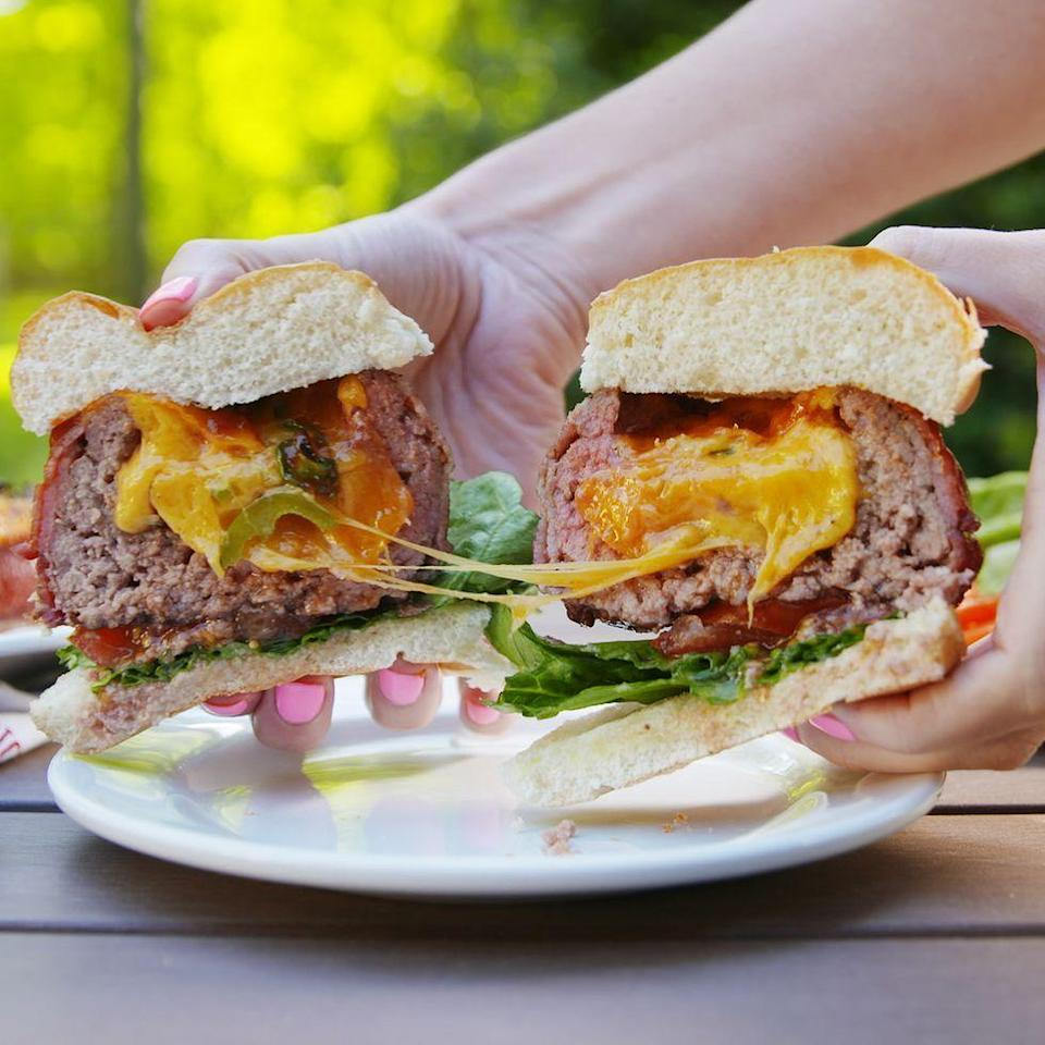 """<p>Just when you thought burgers couldn't get any better...</p><p>Get the <a href=""""https://www.delish.com/uk/cooking/recipes/a34490847/beer-can-burgers-recipe/"""" rel=""""nofollow noopener"""" target=""""_blank"""" data-ylk=""""slk:Beer Can Burgers"""" class=""""link rapid-noclick-resp"""">Beer Can Burgers</a> recipe.</p>"""