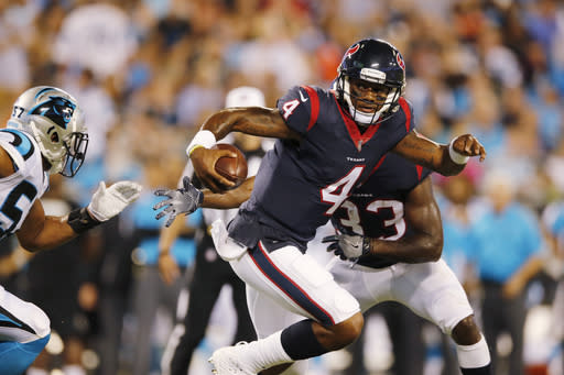 Deshaun Watson went 15-of-25 for 179 yards, was sacked three times and ran for a score. (AP)