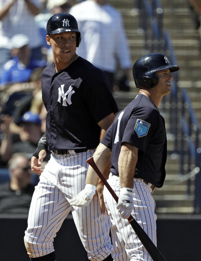 New York Yankees' Aaron Judge, left, and Brett Gardner celebrate after scoring on a two-run double by Gary Sanchez off Pittsburgh Pirates pitcher Sean Keselica during the fourth inning of a spring training baseball game Thursday, March 15, 2018, in Tampa, Fla. (AP Photo/Chris O'Meara)