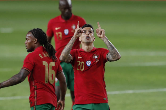Portugal's Joao Cancelo celebrates after scoring his side's third goal during the international friendly soccer match between Portugal and Israel at the Alvalade stadium in Lisbon, Wednesday, June 9, 2021. Cancelo scored once on Portugal's 4-0 victory. (AP Photo/Armando Franca)
