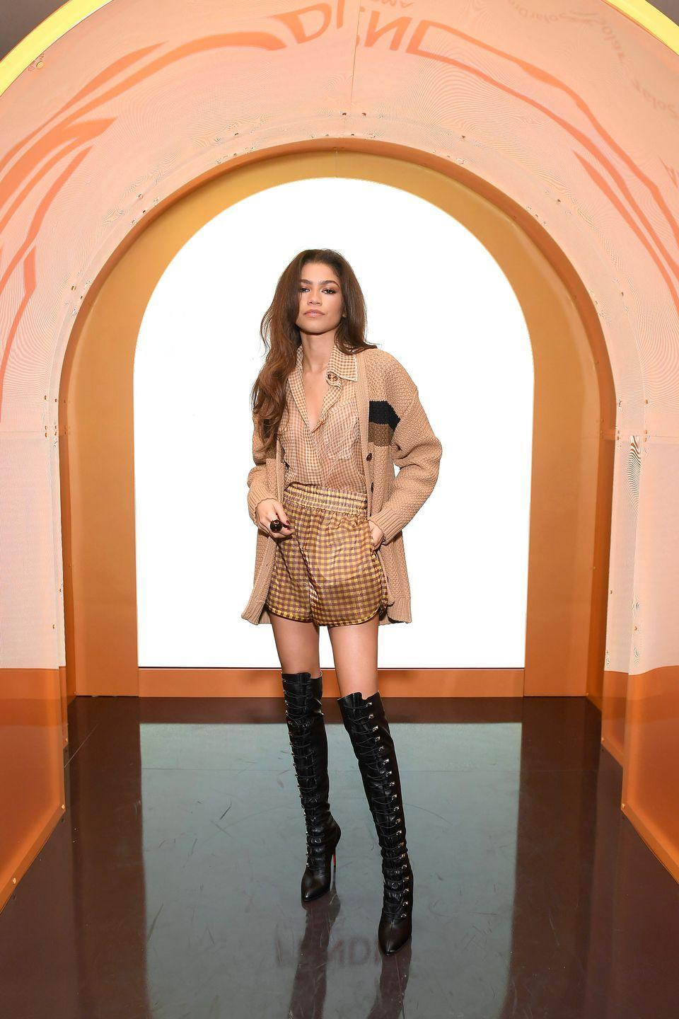 <p>For Fendi's Solar Dream Launch, Z showed up and conquered in a checkered set from the spring 2020 collection. She added some killer thigh-high Louboutin boots to complete the look.</p>