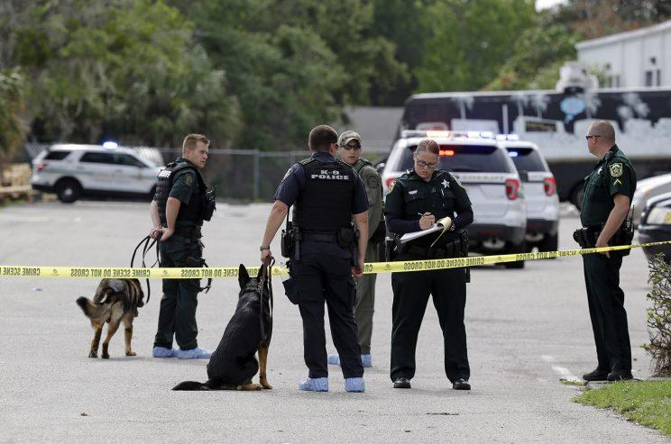 Law enforcement officers, including a K-9 unit, investigate near the scene of a shooting where there were multiple fatalities in an industrial area near Orlando, Fla., Monday, June 5, 2017. (Photo: John Raoux/AP)