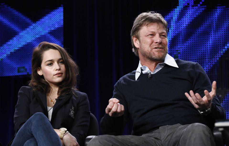 """Cast member Sean Bean answers a question, as co-star Emilia Clarke watches, at the HBO panel for the television series """"Game of Thrones"""" during the Television Critics Association winter press tour in Pasadena, California January 7, 2011. REUTERS/Mario Anzuoni (UNITED STATES - Tags: ENTERTAINMENT)"""