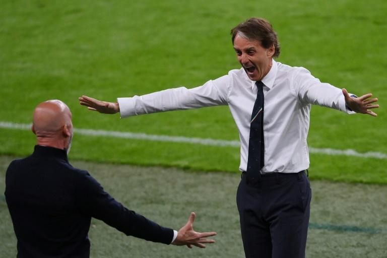 Italy coach Roberto Mancini celebrates after Federico Chiesa's opening goal