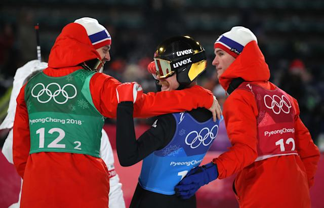 Ski Jumping - Pyeongchang 2018 Winter Olympics - Men's Team Final - Alpensia Ski Jumping Centre - Pyeongchang, South Korea - February 19, 2018 - Robert Johansson of Norway celebrates with team mates Andreas Stjernen and Daniel Andre Tande after winning gold. REUTERS/Carlos Barria