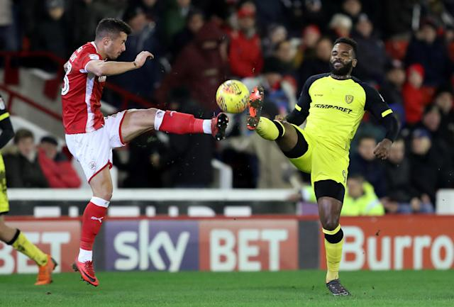 "Soccer Football - Championship - Barnsley vs Burton Albion - Oakwell, Barnsley, Britain - February 20, 2018 Barnsley's Daniel Pinillos in action with Burton Albion's Darren Bent Action Images/John Clifton EDITORIAL USE ONLY. No use with unauthorized audio, video, data, fixture lists, club/league logos or ""live"" services. Online in-match use limited to 75 images, no video emulation. No use in betting, games or single club/league/player publications. Please contact your account representative for further details."