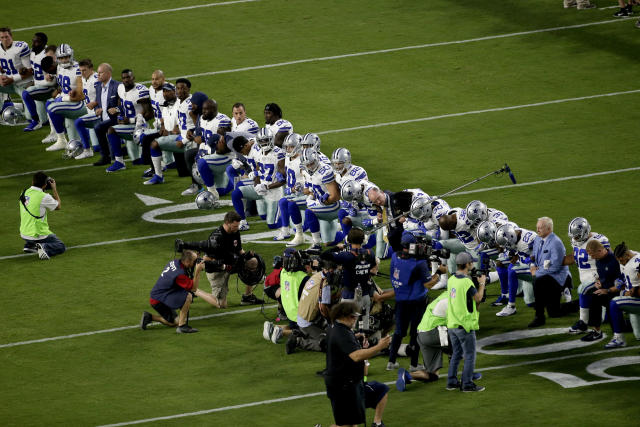 The Dallas Cowboys, led by owner Jerry Jones, far right, take a knee prior to the national anthem on Monday night. (AP)