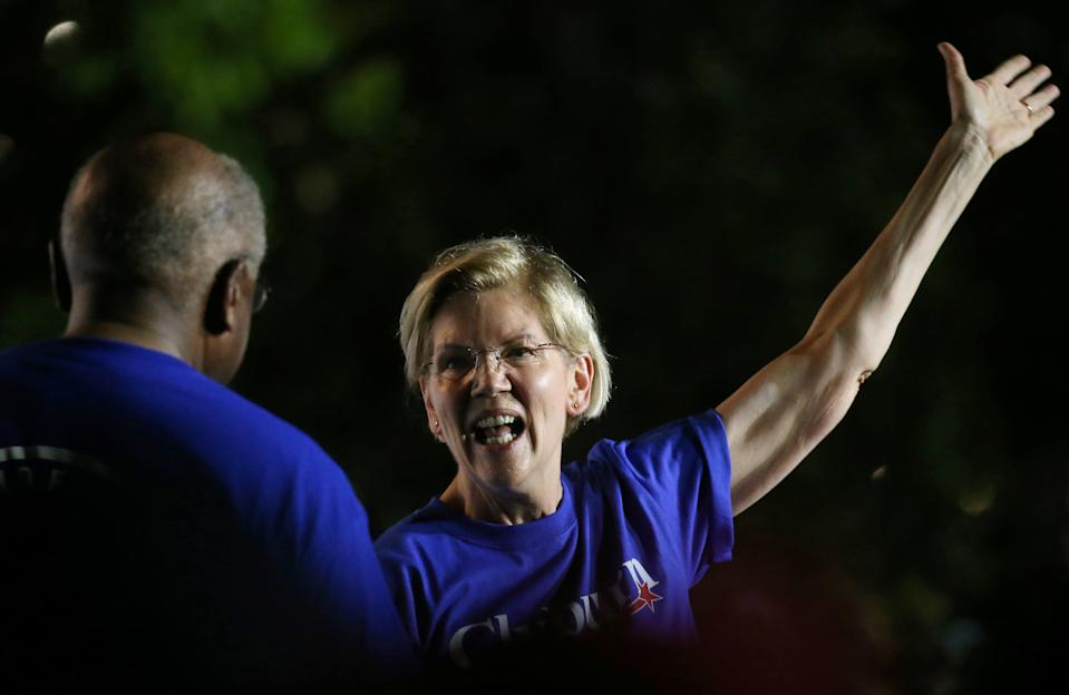 Democratic presidential candidate Elizabeth Warren goes in for a hug with Rep. Jim Clyburn during Jim Clyburn's World Famous Fish Fry in Columbia, South Carolina, U.S., June 21, 2019.  Picture taken June 21, 2019. REUTERS/Leah Millis
