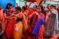 Vishwa Hindu Parishad (VHP) activists dance before the groundbreaking ceremony of the Ram Temple in Ayodhaya, at VHP headquarters in New Delhi on August 5, 2020. - India's Prime Minister Narendra Modi will lay the foundation stone for a grand Hindu temple in a highly anticipated ceremony on August 5 at a holy site that was bitterly contested by Muslims, officials said. The Supreme Court ruled in November 2019 that a temple could be built in Ayodhya, where Hindu zealots demolished a 460-year-old mosque in 1992. (Photo by Prakash SINGH / AFP) (Photo by PRAKASH SINGH/AFP via Getty Images)