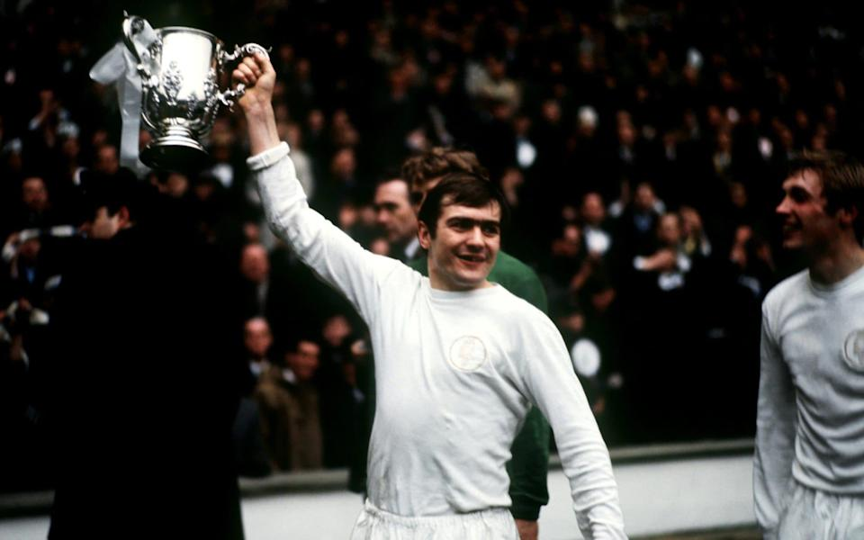 Cooper with the League Cup following Leeds's victory over Arsenal - Peter Robinson/EMPICS Sport